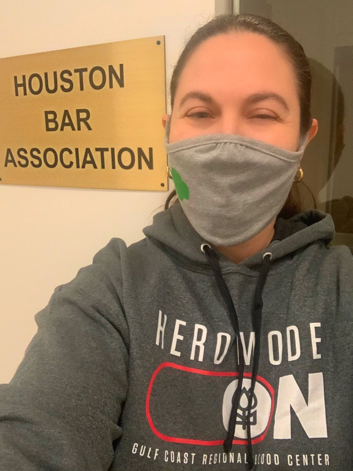 A woman in a mask and the blood donor hoodie