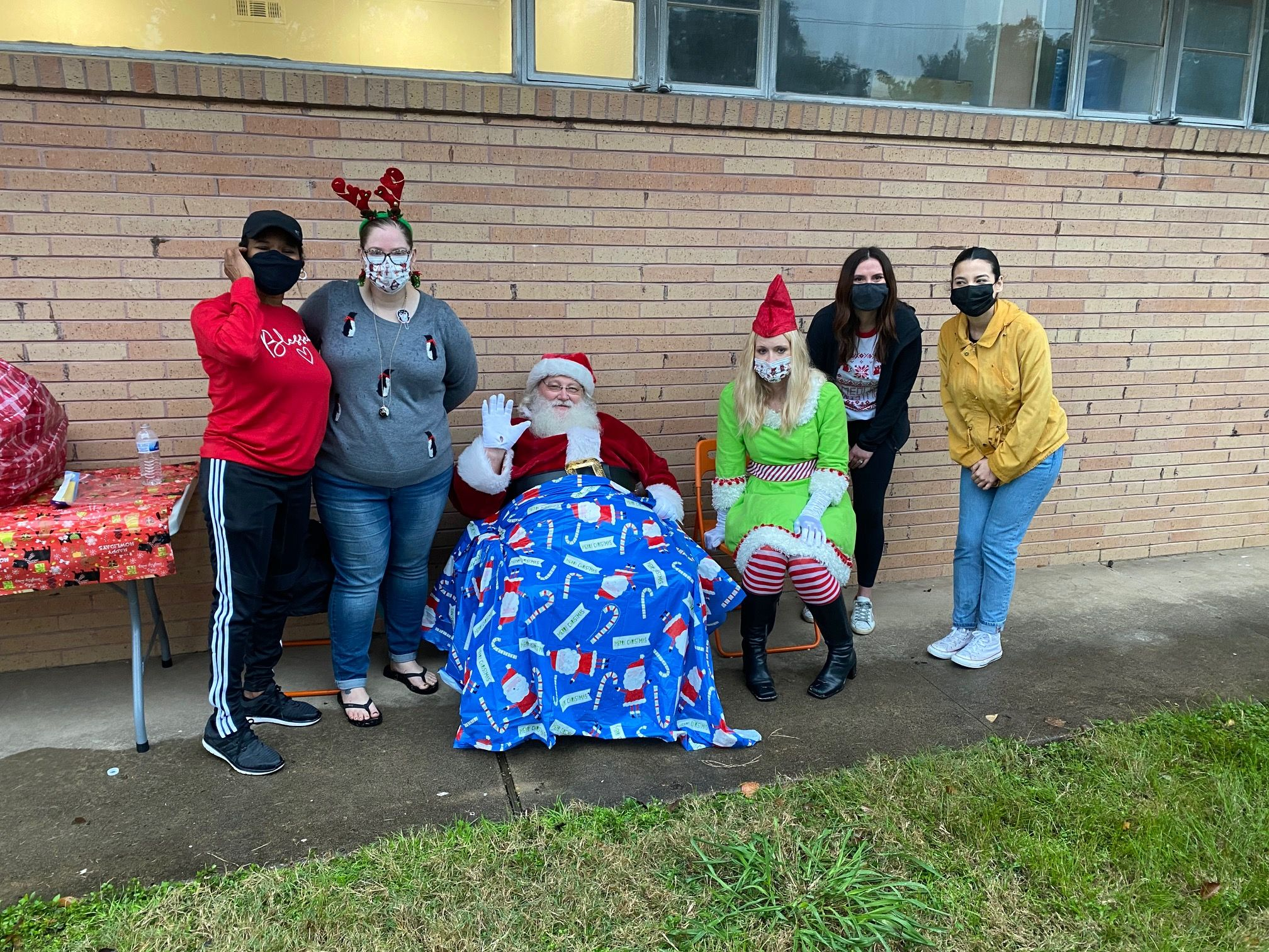 Volunteers pose with Santa Claus