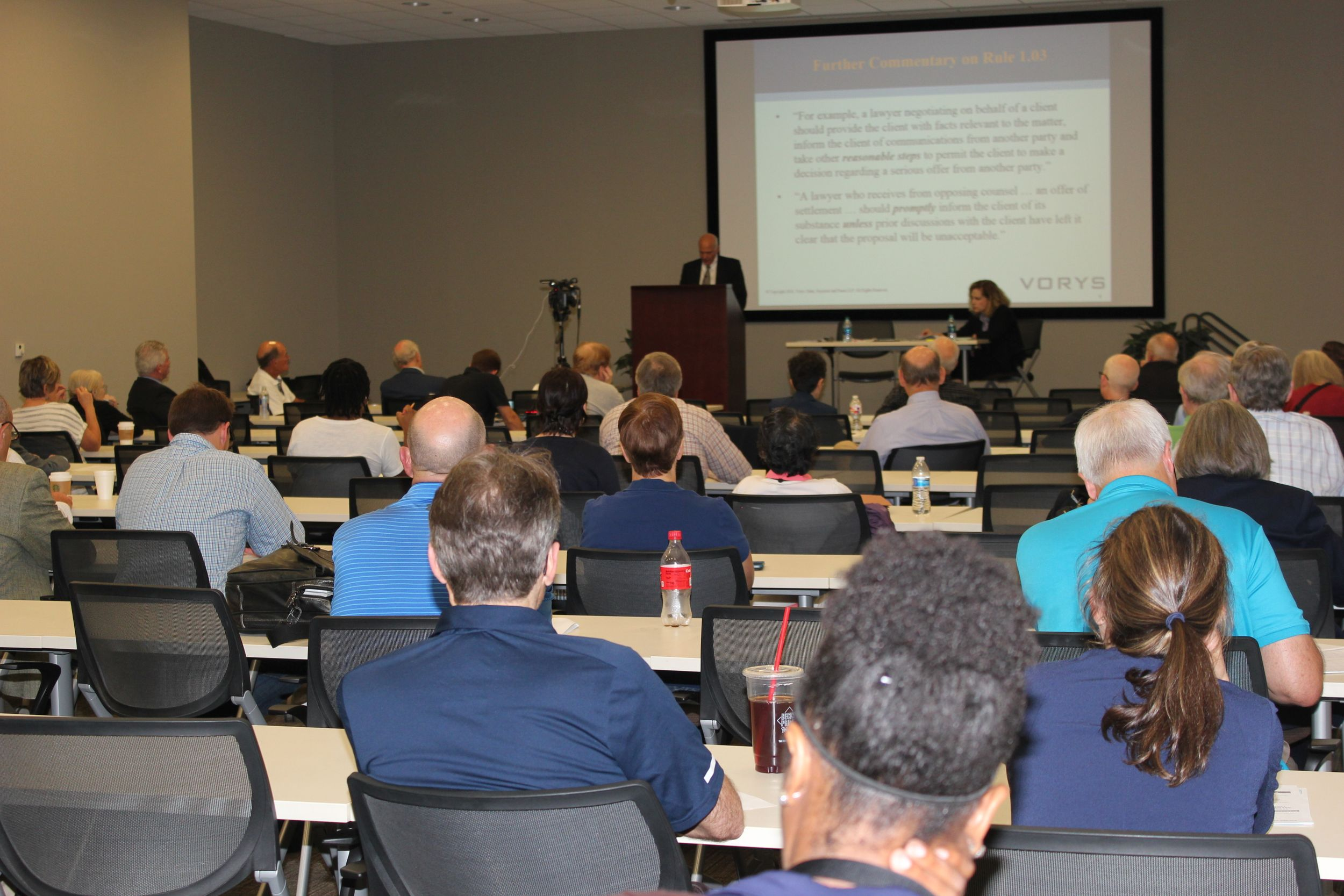 Several attorneys attend an HBA CLE seminar at Heritage Plaza.