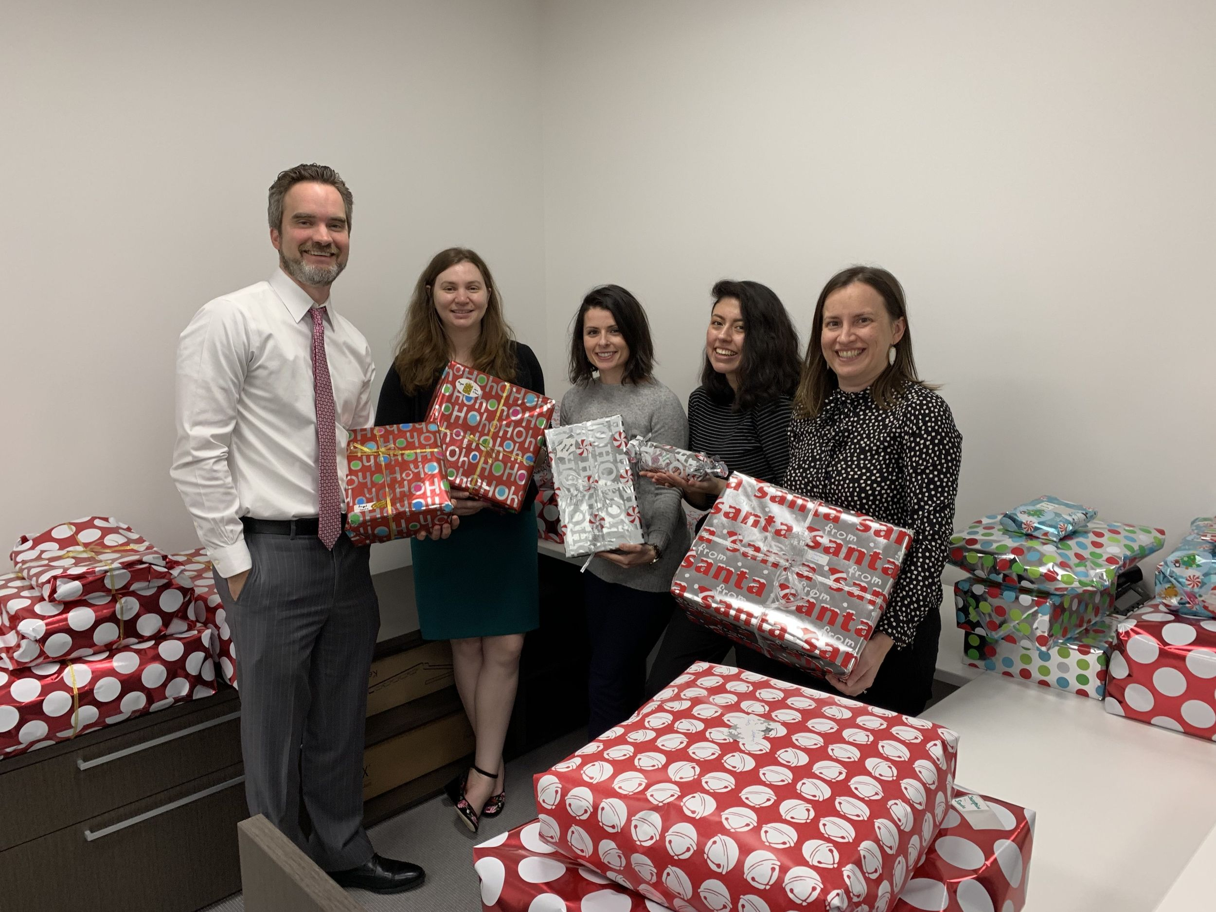McFarland PLLC attorneys show the gifts they will give.