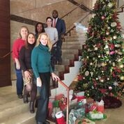 BakerHostetler attorneys with their Adopt-a-Family presents