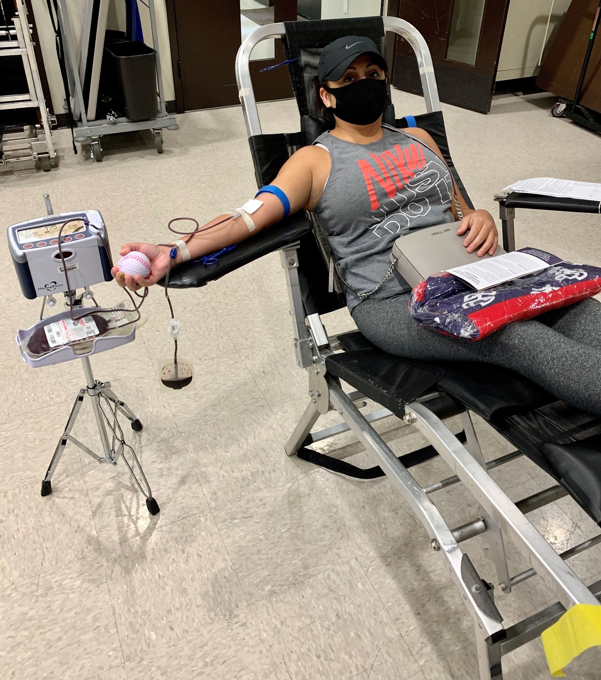 A blood donor reclined in a chair
